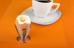 Open egg. Open hardboiled egg on a breakfast table Stock Photos