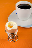 Open egg. Open hardboiled egg on a breakfast table Royalty Free Stock Photo