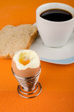 Open egg. Open hardboiled egg on a breakfast table Stock Photo