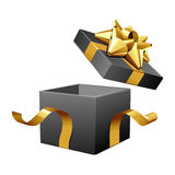 Open empty black gift with gold bow Stock Images
