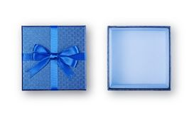 Open empty blue square gift box with shiny satin bow. Isolated on white background Royalty Free Stock Photos