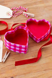 Open empty box in heart shape Stock Images