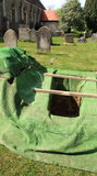 Open empty grave stock photo