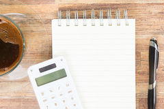 Open empty notebook. With calculator, pen and cup of coffee Stock Photo