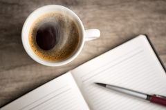 Open empty notebook with coffee cup Royalty Free Stock Photography