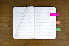Open empty notebook with colorful tabs Stock Photos
