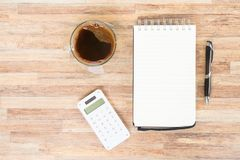 Open empty notebook. With calculator, pen and cup of coffee on wooden table Stock Photos