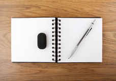 Open empty notebook with pen and eraser. Royalty Free Stock Images