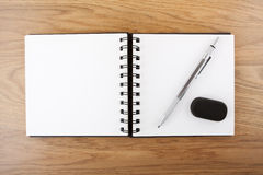 Open empty notebook with pen and eraser Stock Photo