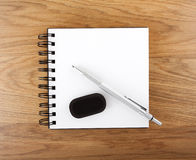 Open empty notebook with pen and eraser Royalty Free Stock Photos