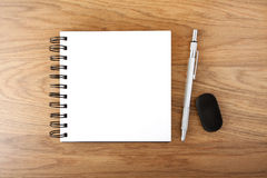 Open empty notebook with pen and eraser Royalty Free Stock Photo