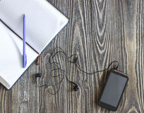 Open empty  notebook with pen and phone Stock Photography