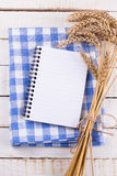 Open empty notebook on wooden background Stock Photo