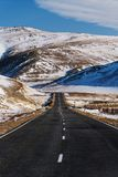 Open empty road with beautiful rodeside view at countryside in winter Royalty Free Stock Photos