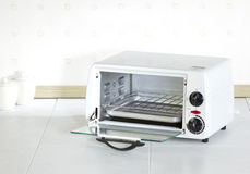 Open empty roaster oven. A useful home appliance in the kitchen stock photo