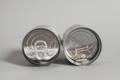Open an empty tin cans on gray Stock Images