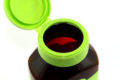 Open empty vitamin bottle. Open green empty vitamin bottle with a flip top Stock Photography