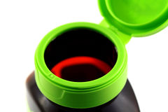 Open empty vitamin bottle. Open green empty vitamin bottle with a flip top Royalty Free Stock Image