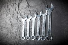 Open-end wrench set. On dark stone background Royalty Free Stock Photo