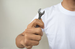 Open-ended wrench in hand a man Royalty Free Stock Photography