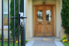 Open entrance iron gate. And blurry entance door on background stock photography