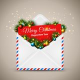 Open envelope and card Merry Christmas with fir Stock Photography