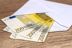 Open an envelope with euro banknotes on table. Open an envelope with euro banknotes on the table Royalty Free Stock Images