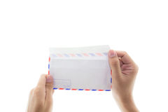 Open envelope with hand isolated. Stock Photo