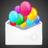 Open envelope with multicolored balloons. Stock Photo