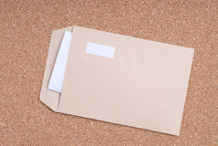 Open Envelope  and paper on cork background Royalty Free Stock Images