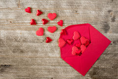 Open envelope with red hearts. Royalty Free Stock Image