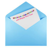 Open envelope with text Merry Christmas - light blue stock photography