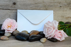 Open envelope on wooden seat Royalty Free Stock Photos