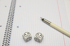 Open exercise book with mood dice (sad) Stock Image