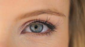 Open eye of a beautiful woman stock footage