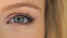 Open eye of a beautiful woman stock video