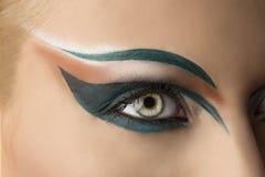 Open eye closeup with makeup. Girl's eye closeup with creative green makeup. it's open Royalty Free Stock Photography