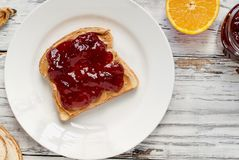 Open Face Peanut Butter and Strawberry Jelly Sandwich with Fruit royalty free stock photography