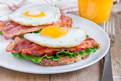 Open face sandwich with egg, bacon, tomato and lettuce Royalty Free Stock Image
