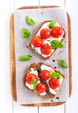 Open-face tomato and cheese bruschetta Royalty Free Stock Image