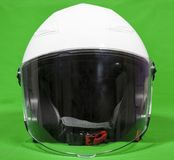 Open face white motorcycle helmet with attached face shield, front view, a green background Royalty Free Stock Photos