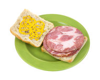 Open faced capicolla sandwich with mustard Stock Photo