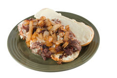 Open faced cheesesteak on white Royalty Free Stock Image
