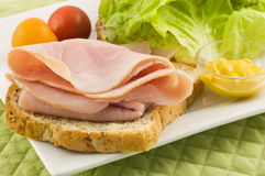 Open faced ham sandwich. On whole grain bread with lettuce and cherry tomatoes makes a healthy lunch Stock Photography