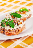 Open faced sandwices with goat cheese, almonds and arugula. Shallow dof stock images