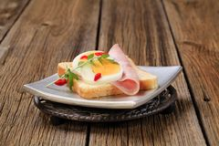 Open faced sandwich. White bread with boiled egg and ham Stock Photography