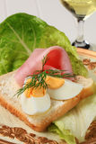 Open faced sandwich. White bread with boiled egg and ham Royalty Free Stock Images