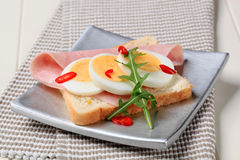 Open faced sandwich. White bread with boiled egg and ham Stock Photos