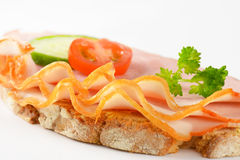 Open faced sandwich. Detail of open faced ham sandwich on white background Stock Images
