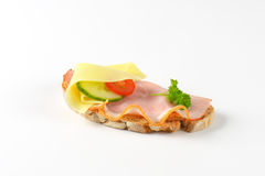 Open faced sandwich. With ham and cheese on white background Stock Photography
